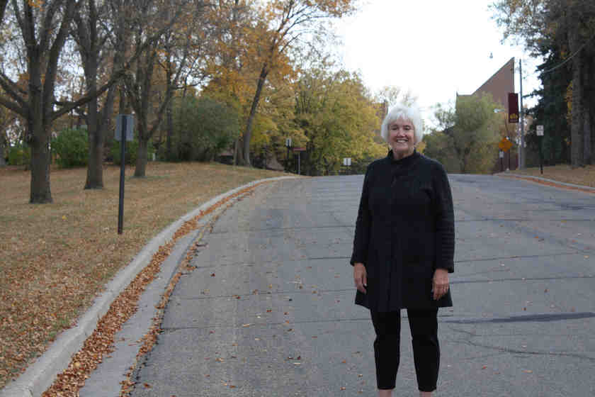 A woman standing on a residential road